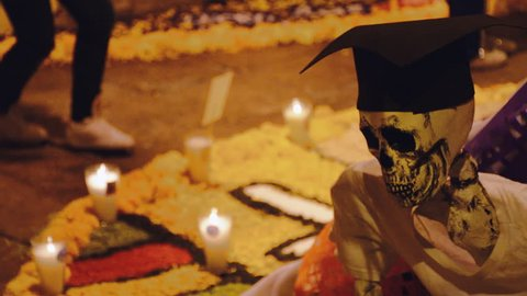 Day of the dead: traditional ornamental skeleton on a grave during the Mexican festival Día de los muertos
