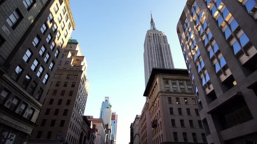 NEW YORK CITY, USA - SEPT 22, 2018: drone shot of NYC New York City Manhattan iconic skyscrapers with Empire State Building. NYC is a popular tourist travel destination.