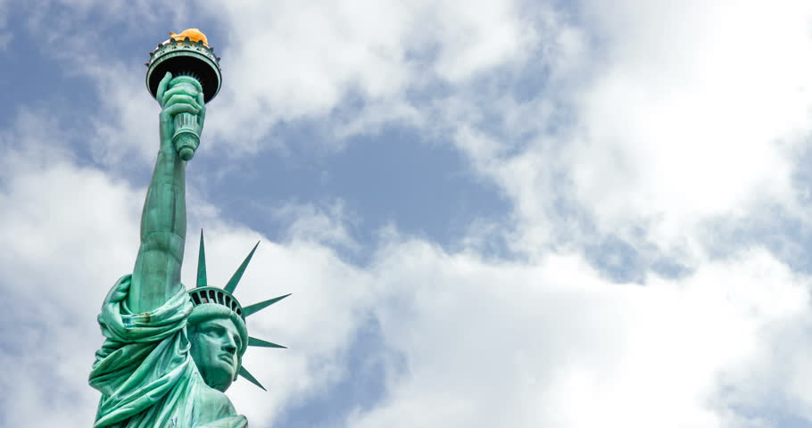 New York, The Statue of Liberty. Patriotic symbol rapid clouds sky time lapse | Shutterstock HD Video #1017504502