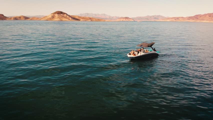 4K DRONE FOOTAGE; PANNING AROUND BOAT IN LAKE, OPEN WATER | Shutterstock HD Video #1017526042