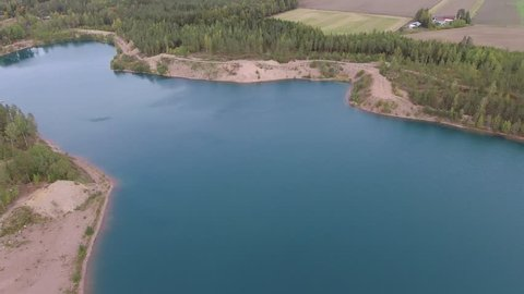 Aerial view of sandpit man made lake.