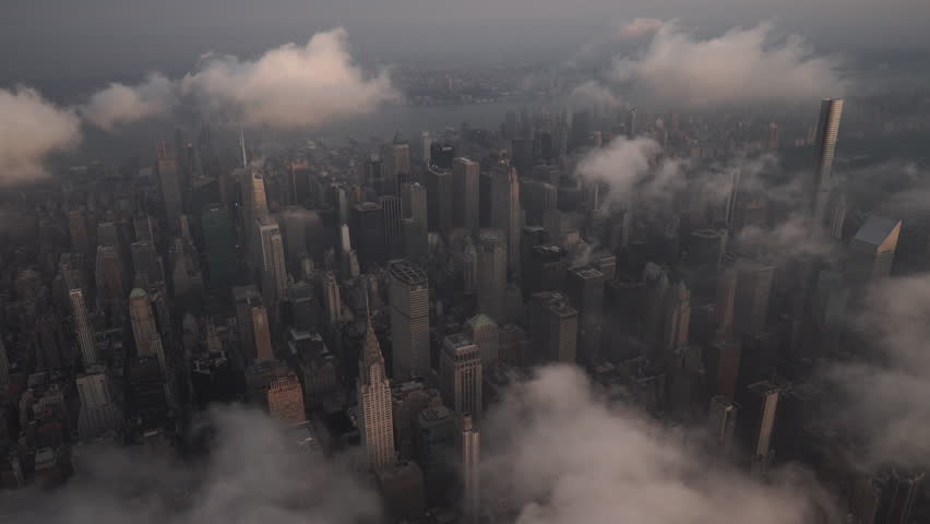 New York City Circa-2015, aerial view of Midtown Manhattan at sunrise, featuring famous landmarks under low level clouds