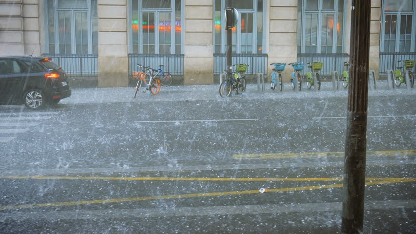 Extreme weather hail rain storm on the streets of Paris hail beats bicycles | Shutterstock HD Video #1017598042