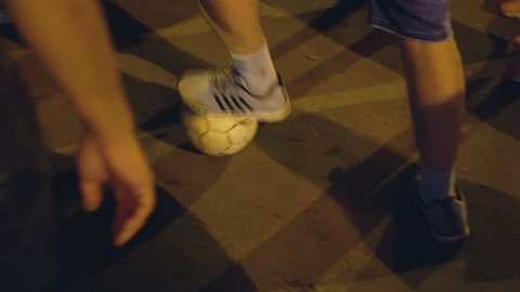 Russia, Novosibirsk, July 2, 2018: Victory of Russia in a football match. People celebrate victory. The crowd celebrates the victory of a football match. guy plays ball on street during victory party.