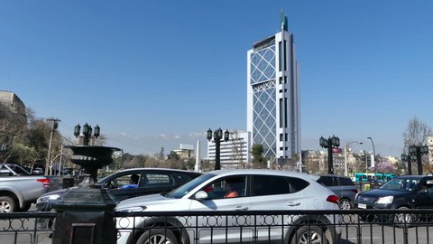 SANTIAGO, CHILE - Sep 11 2018. Heavy traffic on the Pio Nono bridge. Cars and pedestrians passing by while the Telephone Tower, Andes Mountains, Plaza Italia Obelisk and Mapocho river are all visible.