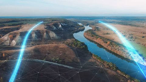 4k Aerial view The concept of disseminating information, data flows over a natural landscape with a river and mountains