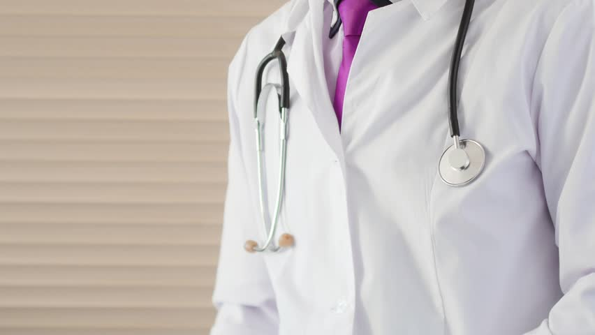 Confident medical doctor showing OK sign by fingers. Success symbol in healthcare | Shutterstock HD Video #1018106992