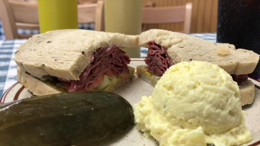 Pastrami Sandwich with Pickle and Potato Salad | Shutterstock HD Video #1018159432