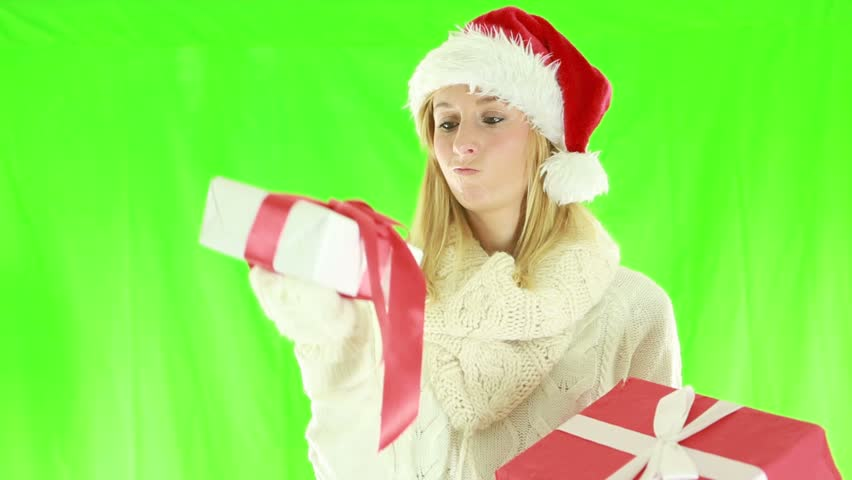 Woman choosing Christmas presents. Young woman trying to decide which Christmas present to buy. Green screen    Shutterstock HD Video #1018174822