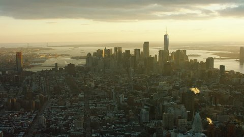 Aerial view of downtown Manhattan cityscape and skyline, New York City, bright winter sunset light. Wide shot. 4k shot with a RED camera.