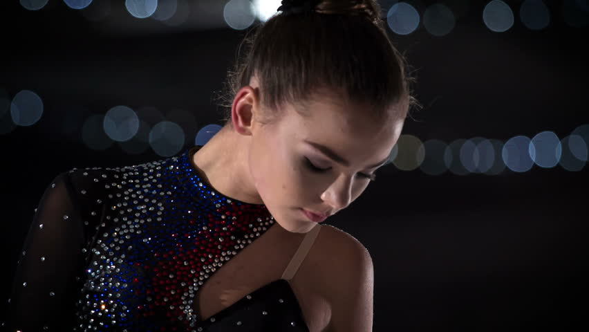 A figure skater lifts her head up and her performance is about to start. | Shutterstock HD Video #1018282462