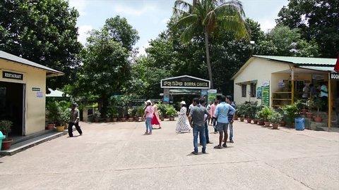 Araku Valley,  Visakhapatnam, Andhra Pradesh, India : Tourist walk through the entrance of Borra Caves in Araku Valley  on Aug 23 - 2018