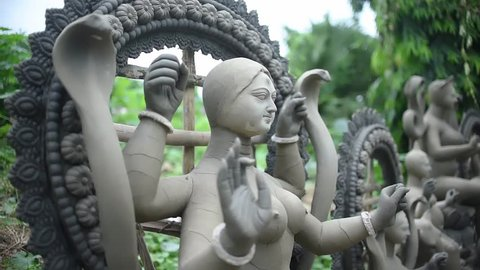 Unfinished clay sculptures of Indian Gods and Goddesses are being constructed outdoor