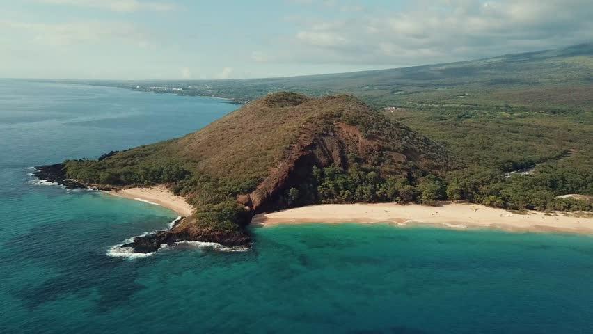 Island with two white sand beach. Maui, Makena big beach. Aerial view