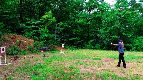 Jasper, GA / United States - 07 29 2018: Woman practicing at outdoor pistol target range