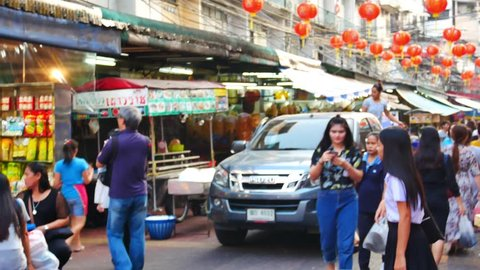 BANGKOK, THAILAND - OCT 5, 2018: Cars and shops on Yaowarat road. Chinatown with notable Chinese buildings, restaurants and decoration. Busy Yaowarat Road in the evening. chinese new year