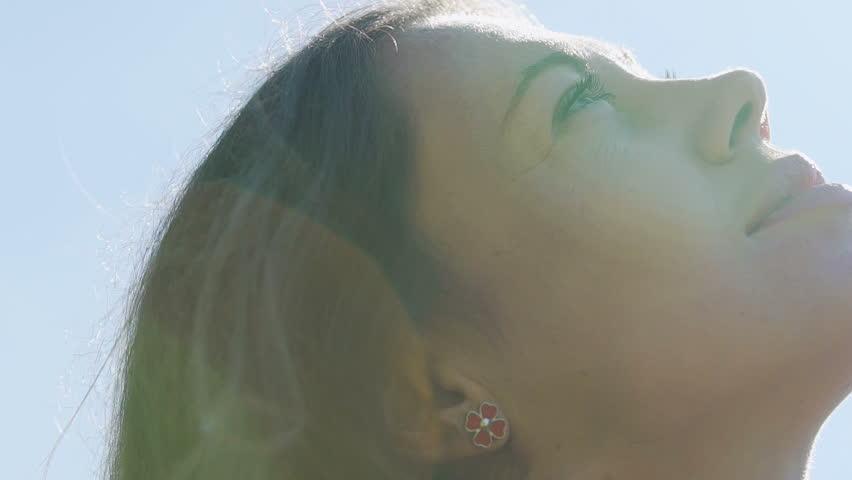 Beautiful lady looks up sky God believer prayer, passionate dreamer divine light   Shutterstock HD Video #1018454332
