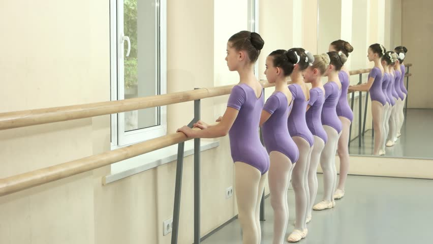 Ballerinas performing ballet exercise at barre. Group of teen ballet-dancers are training at ballet school. Kids ballet studying. | Shutterstock HD Video #1018605652