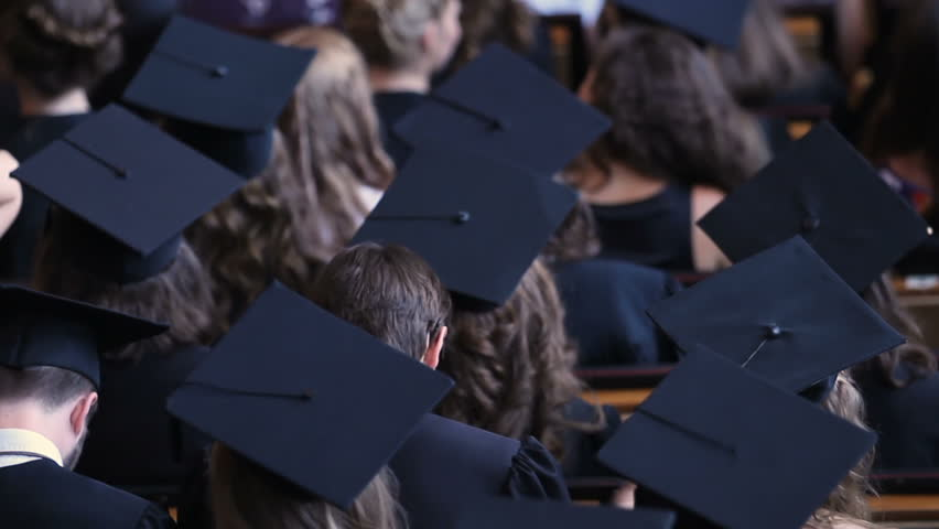 Young men and women in academic dress applauding, graduation ceremony, education | Shutterstock HD Video #1018619662