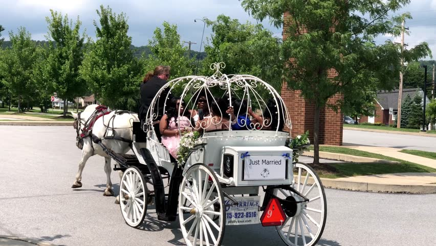 Coatsville, PA / United States - 08 18 2018: August 18, 2018 Wedding Carriage Ride