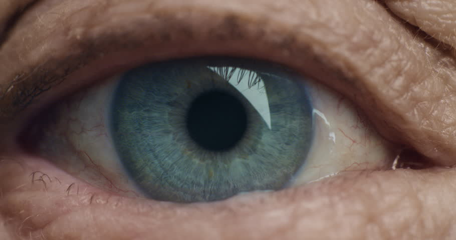close up blue eye opening old woman blinking macro aging beauty optometry concept #1018688812