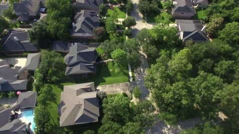 This video is of an aerial view of homes in affluent neighborhood in Houston, Texas. This video was filmed in 4k for best image quality.