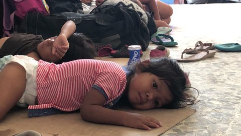 Chiapas, Mexico - November 1, 2018: Immigrant Caravan Children Sleeping on Cartons in Mexico