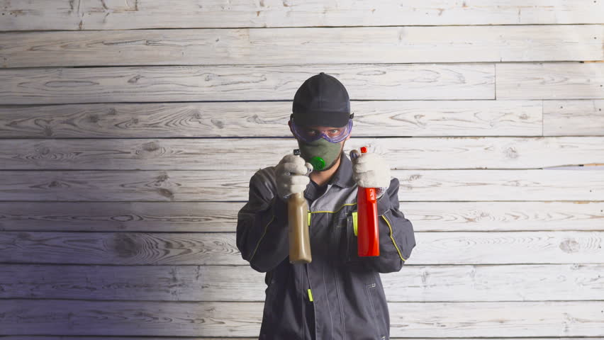 Portrait of a man with spray ready to cleaning something | Shutterstock HD Video #1018859002