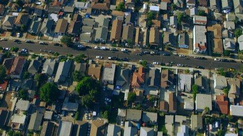Los Angeles, California circa-2018: Aerial view of suburban houses near Olympic stadium on a sunny day in Los Angeles, California. Shot on 4K RED camera.