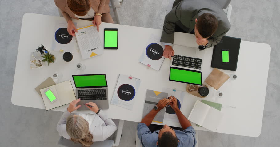 Multi ethnic business team brainstorming innovative ideas for startup company viewing chroma key using mobile computer technology in boardroom meeting above view | Shutterstock HD Video #1019015002