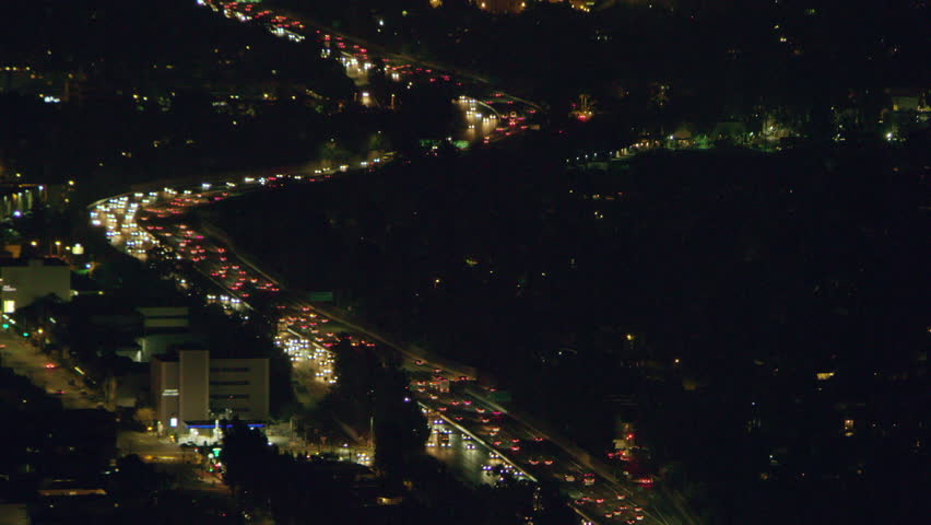 Aerial view of highway traffic on a clear night in Los Angeles, California. Shot on 4K RED camera.