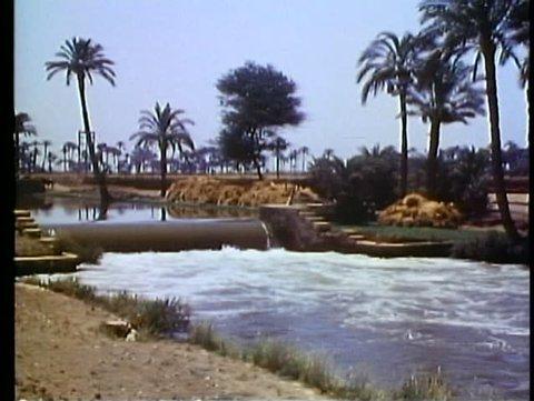 FAYOUM OASIS, EGYPT, 1977, Main irrigation canal, small waterfall