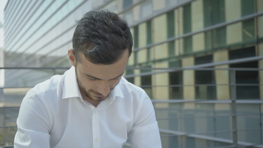 Medium shot of young Caucasian manager suffering from headache. Tired specialist in white shirt touching forehead and looking up. Static camera. Need fresh air concept | Shutterstock HD Video #1019102152
