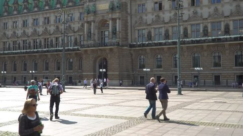 Hamburg, Hamburg / Germany - 08 20 2018: Sunny morning with people passing at the townhall of Hamburg, Germany