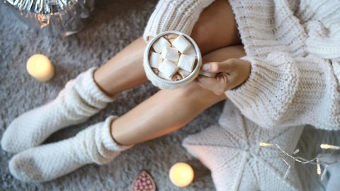 Cup Of Hot Chocolate With Marshmallow And Woman Legs In Cozy Knitted Socks
