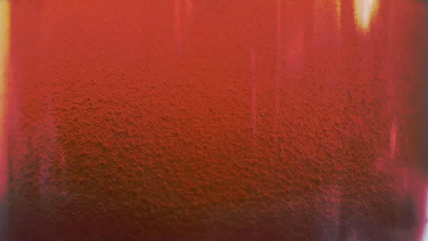 Red liquid with air bubbles #1019210542