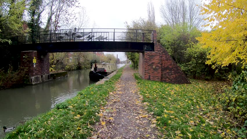 Coventry, Warwickshire, UK - November 9, 2018: Hyper lapse walk of the canal and locks at Hawkesbury junction where the Oxford canal meats the Coventry canal on a cloudy autumn day