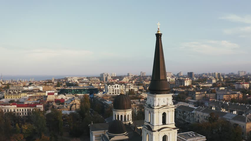 Aerial drone rotation around the spire of Preobrazhensky Cathedral Odessa during sunset | Shutterstock HD Video #1019260882