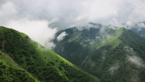Clouds in the mountains of Chechnya. The road to Lake Kesanoiyam. Green Mountains. Time lapse with clouds.
