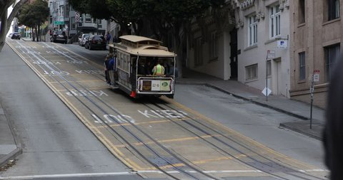 SAN FRANCISCO, USA - APRIL 13, 2013 Cars Traffic and Cable Car Transport People Commuters Commuting in San Francisco