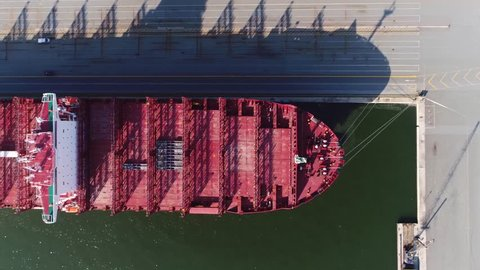 Aerial top down view of empty container ship is cargo vessel that carries all of load in truck-size intermodal containers in technique called containerization and carry most seagoing non-bulk freight