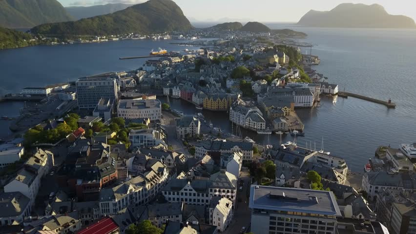 Alesund drone shot of town on west coast of Norway. Entrance to the Geirangerfjord aerial view in evening. Surrounding archipelago and fjord. Ålesund finest views   Shutterstock HD Video #1019322112