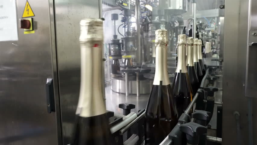 Sennoy, Russian Federation – February 15, 2018: The line for filling and sealing the conveyor in a factory of champagne | Shutterstock HD Video #1019381812