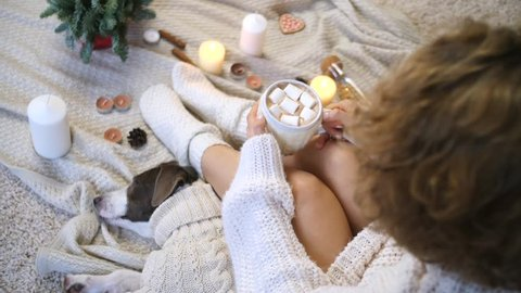 Female In Knit Sweater And Socks Holding Hot Cacao Cup At Home