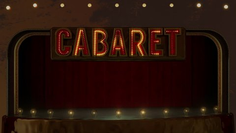 Red bold Cabaret sign with twinkling yellow lights above empty stage surrounded by large round light bulbs and dark red curtains