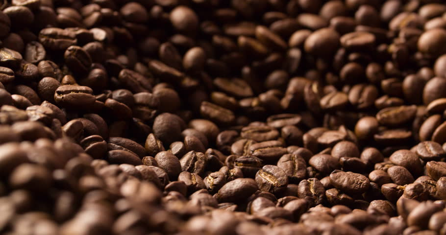 Coffee beans roasted rotating blurry background close up macro shot abstract 4K video. | Shutterstock HD Video #1019437432