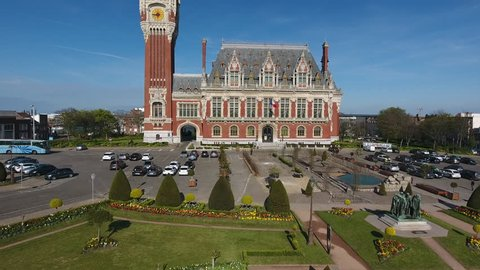 Calais distinctive town hall with a 74m high clock and belfry. Aerial drone view up and down