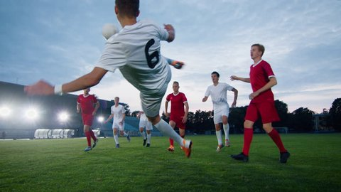 Soccer Player Receives Successful Pass and Kicks Ball and Scores Amazing Goal doing Doing Verticle Bicycle Kick. In Slow Motion.
