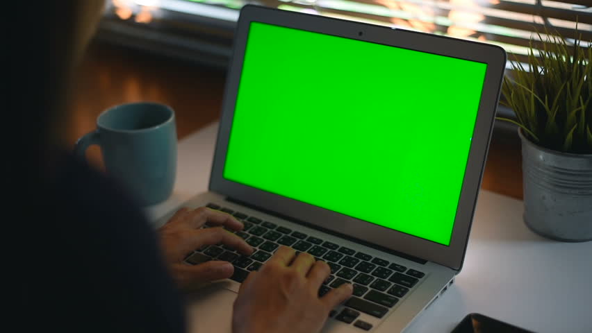 Woman working at home on with laptop green screen | Shutterstock HD Video #1019555542