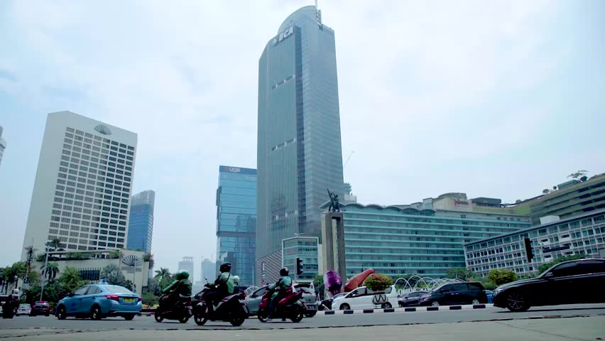 Jakarta, Indonesia - October 26, 2018 : Life routine in Jakarta. View of the Hotel Indonesia roundabout with Welcome monument in Jakarta central business district. | Shutterstock HD Video #1019607592
